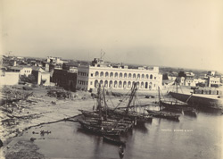 [View of the harbour at Veraval with the town beyond.]